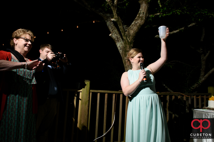 Toasting the couple.