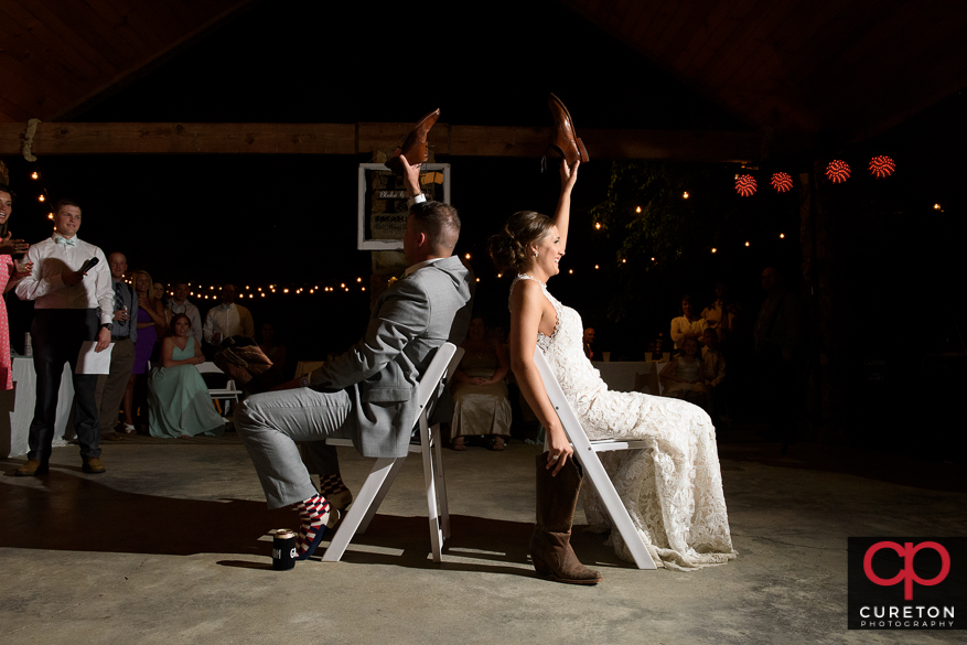 Bride and groom play the shoe game.