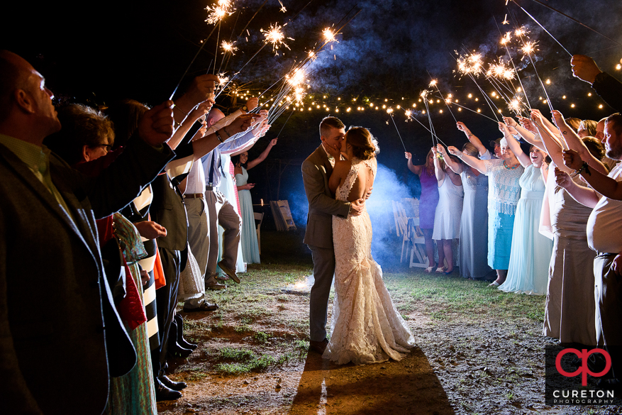 Bride and groom have an epic sparkler leave after the wedding reception at Song Hill Reserve.