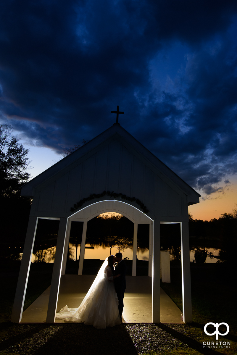 Bride and groom dancing in the chapel at the South Wind Ranch wedding venue in Travelers Rest,SC.