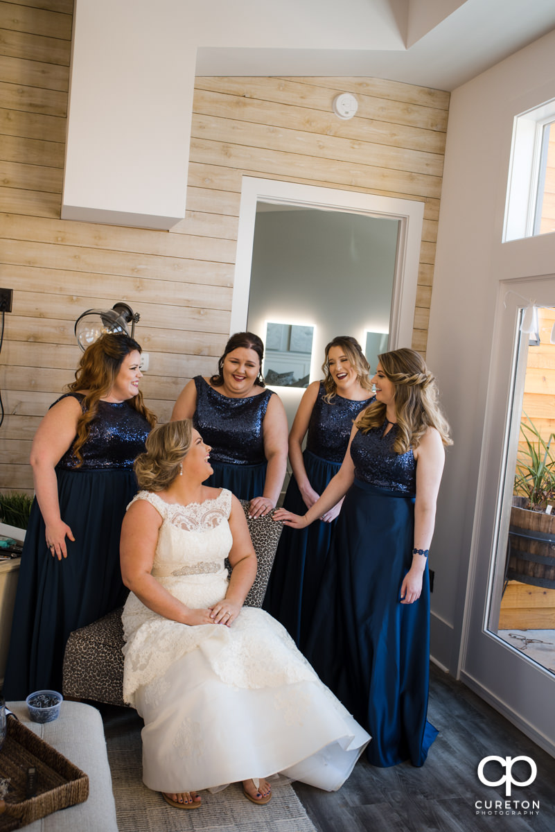 Bride laughing with her bridesmaids in the bridal suite at South Wind Ranch