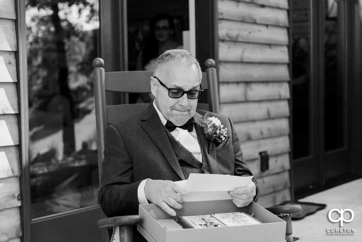 Bride's father reading a note from his daughter.