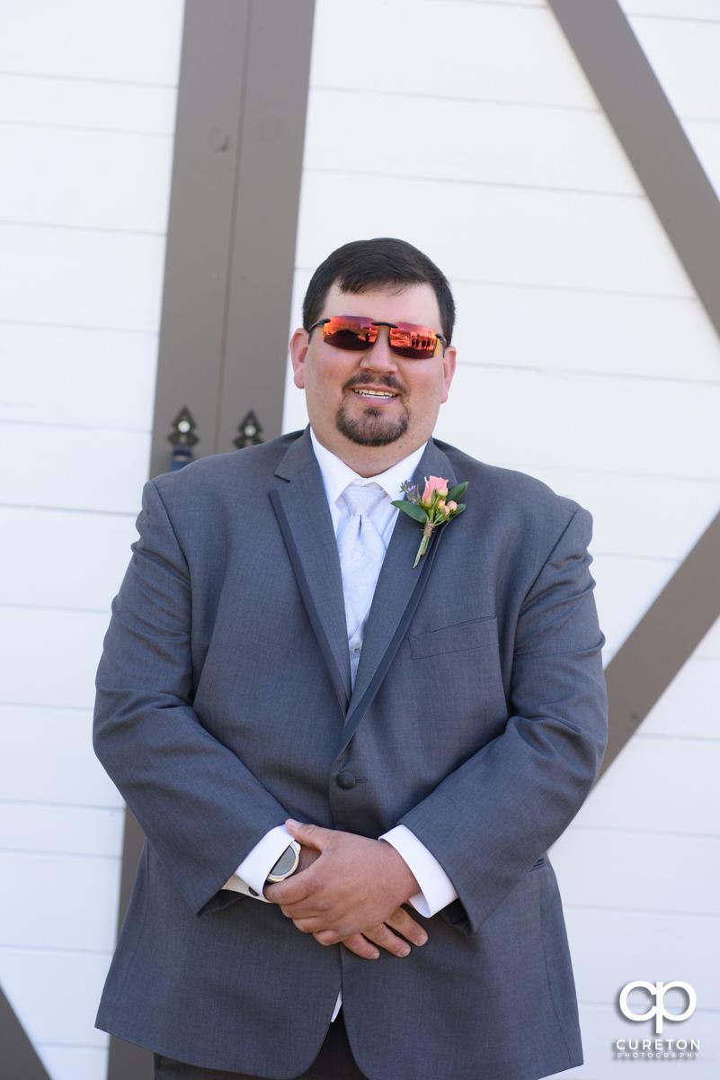Groom wearing sunglasses.
