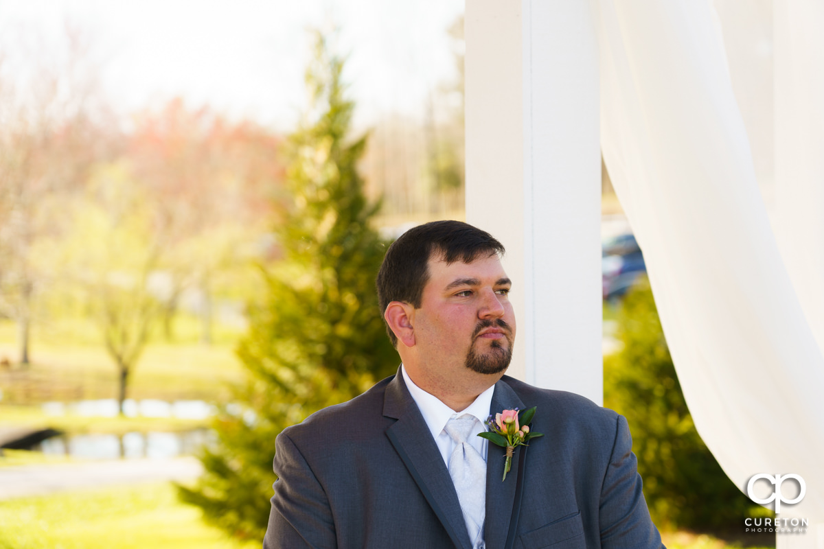 Groom waiting on his bride.