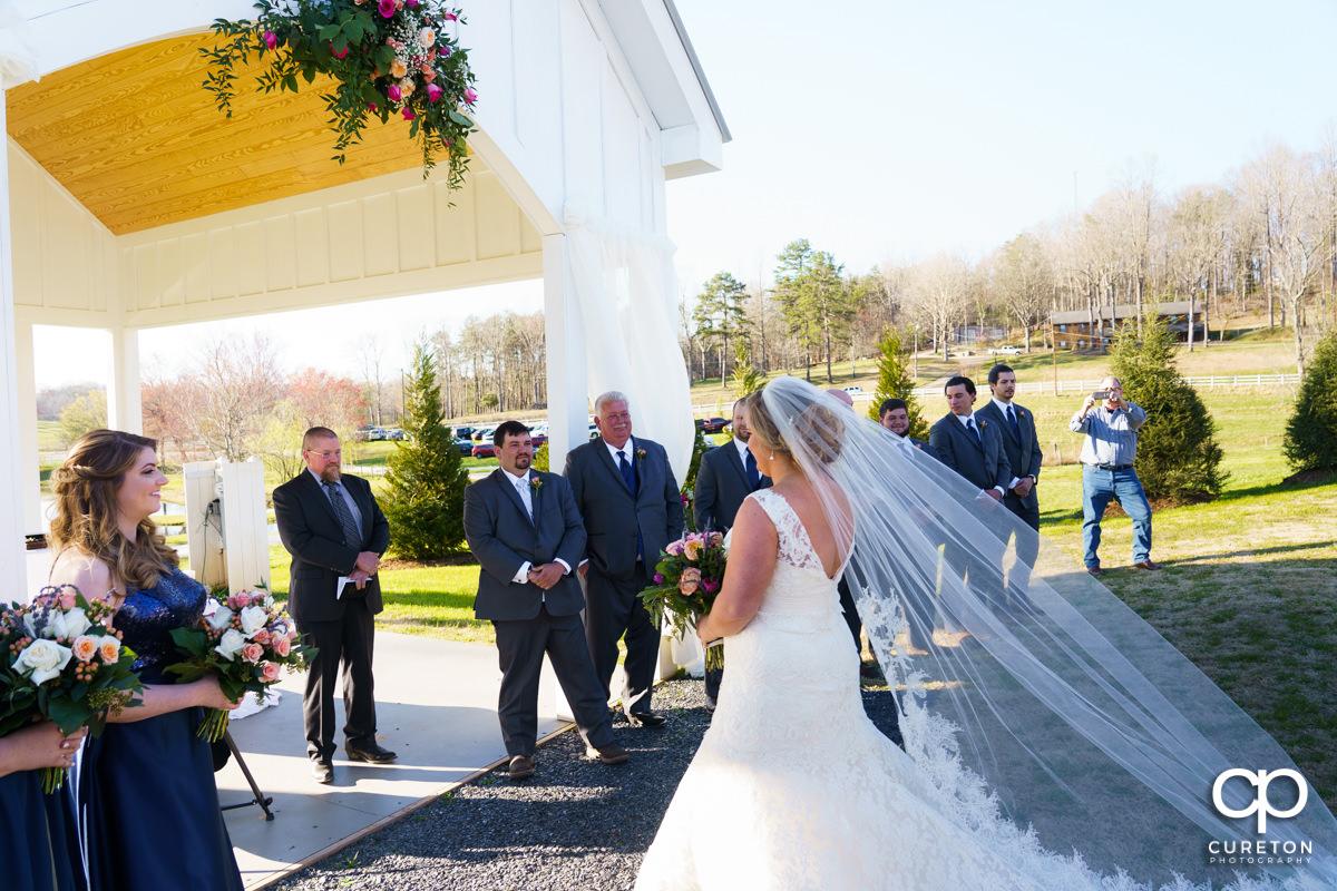 Bride walking up to her groom.
