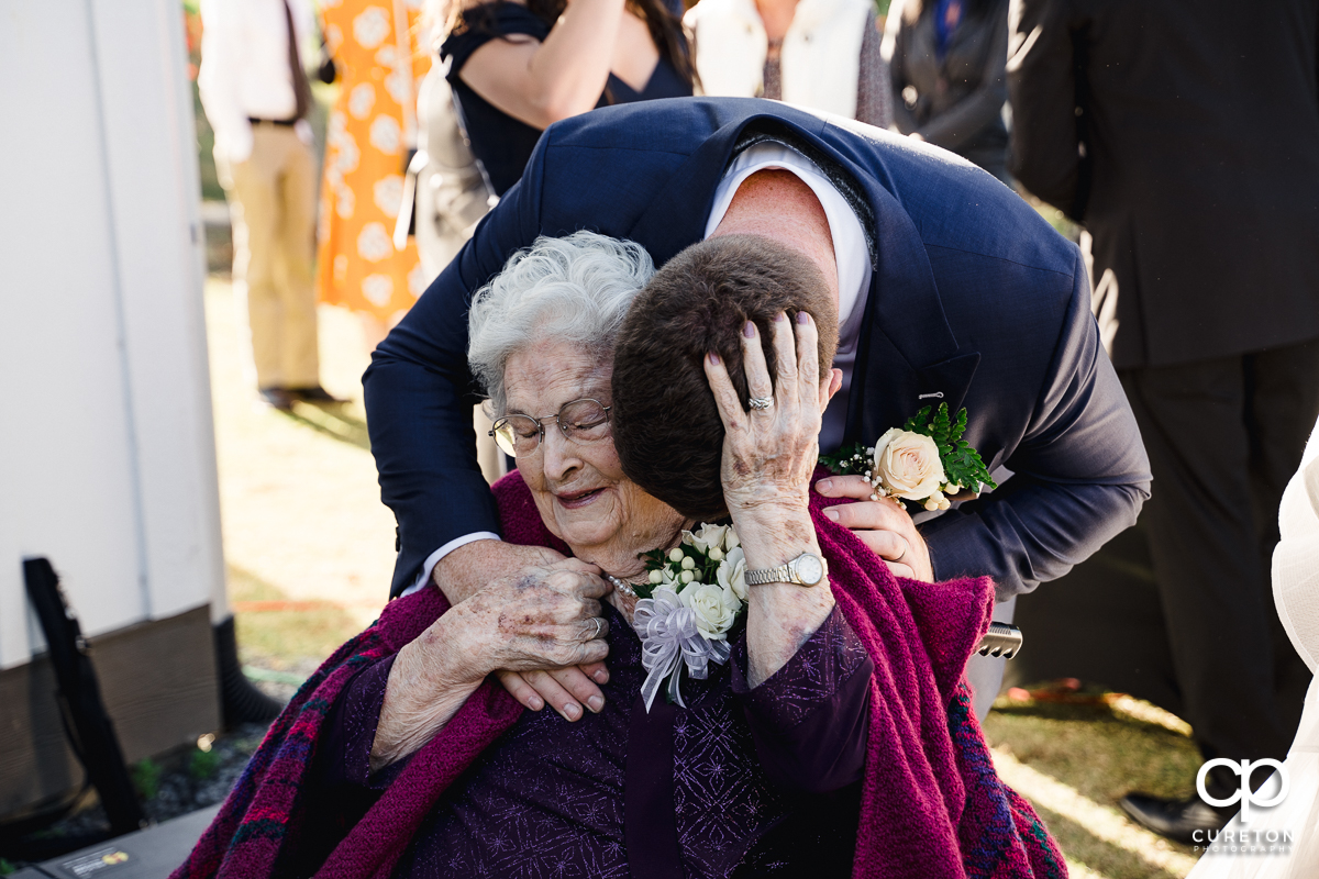 Groom hugging his grandma after the wedding ceremony.