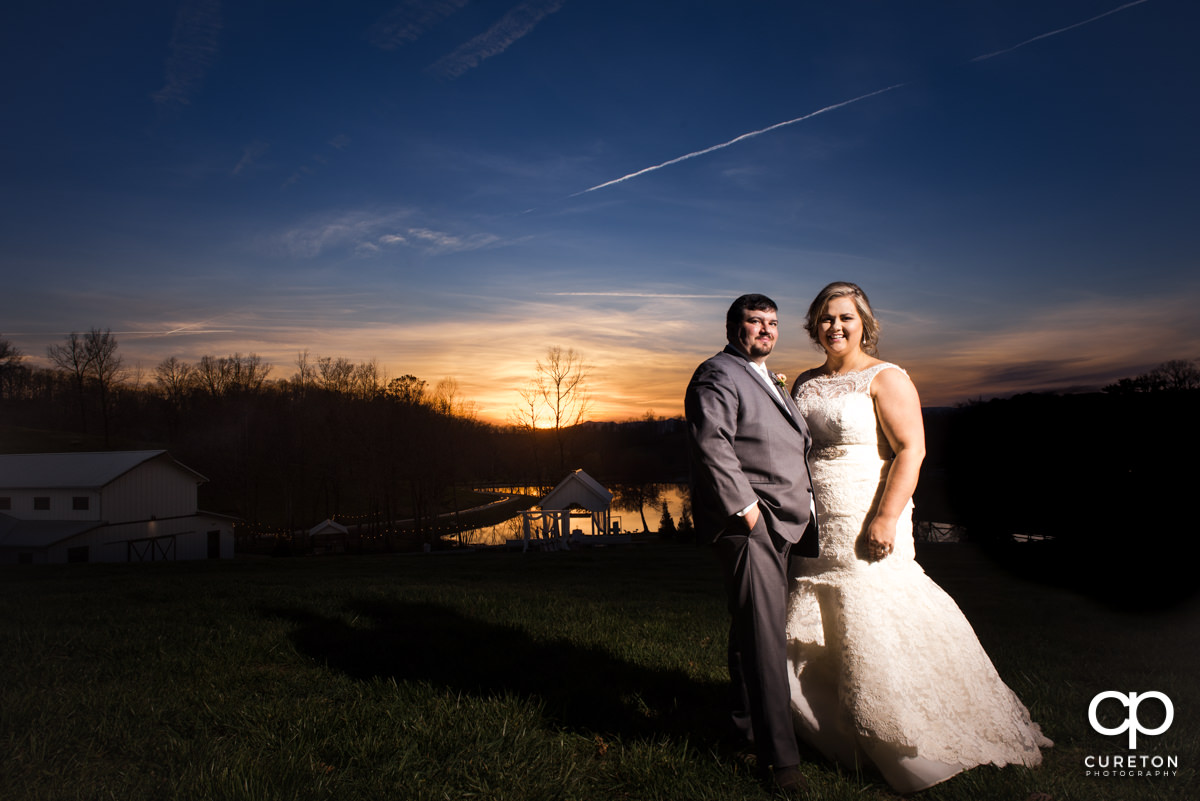 Bride and groom at sunset during their South Wind Ranch wedding in Travelers Rest,SC.