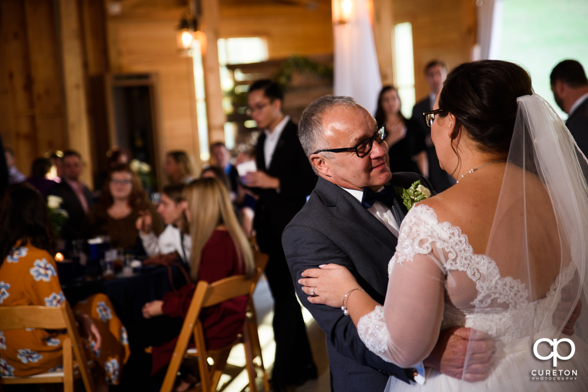 Bride's father sharing a dance with her at her South Wind Ranch wedding reception.