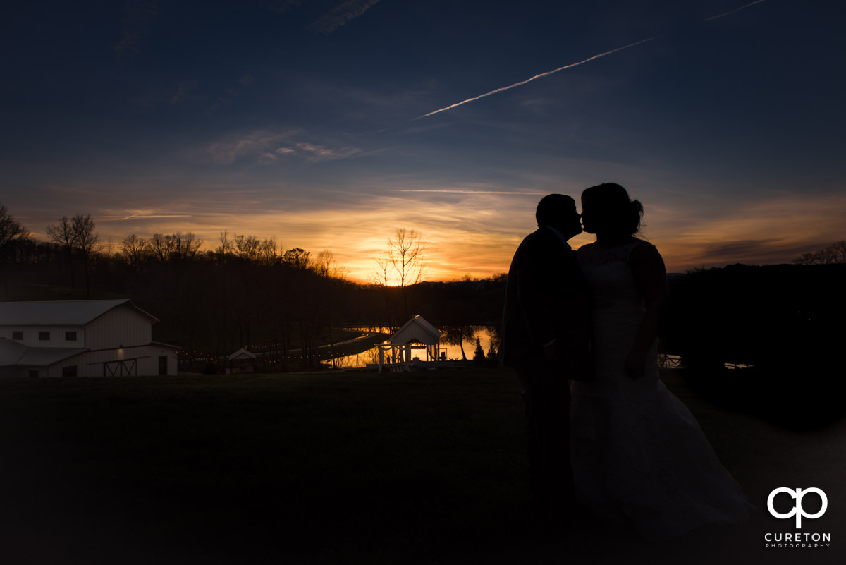 Bride and groom sihouette during their South Wind Ranch wedding in Travelers Rest,SC.