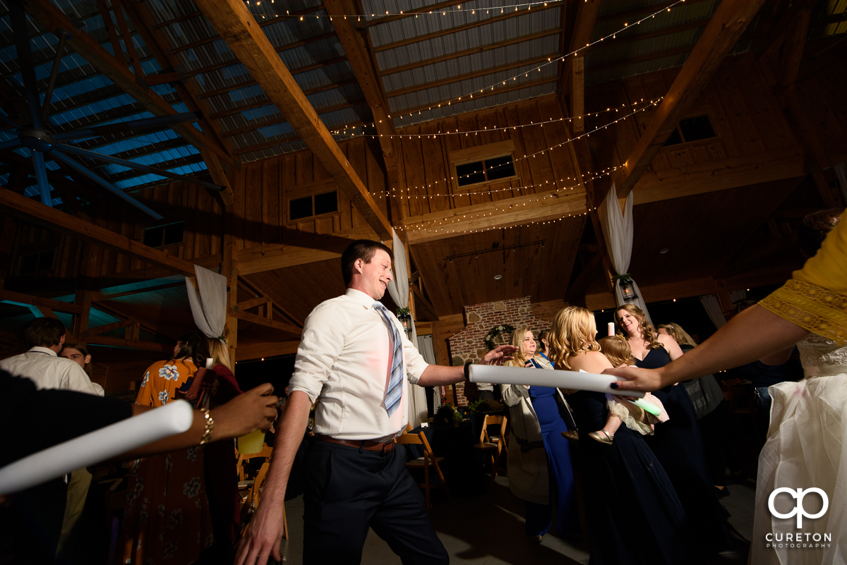 Wedding guests dancing at South Wind Ranch.