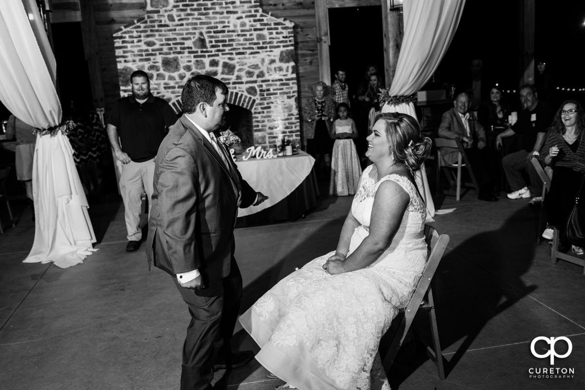 Groom dancing for the bride.