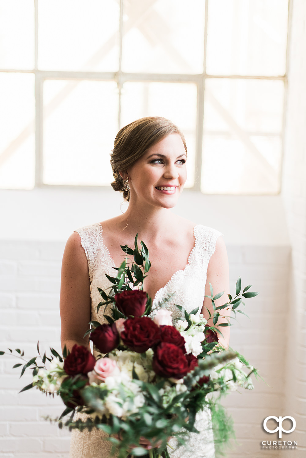 Bride holding a gorgeous bouquet during her bridal session at The Southern Bleachery wedding venue at the Taylor Mill.