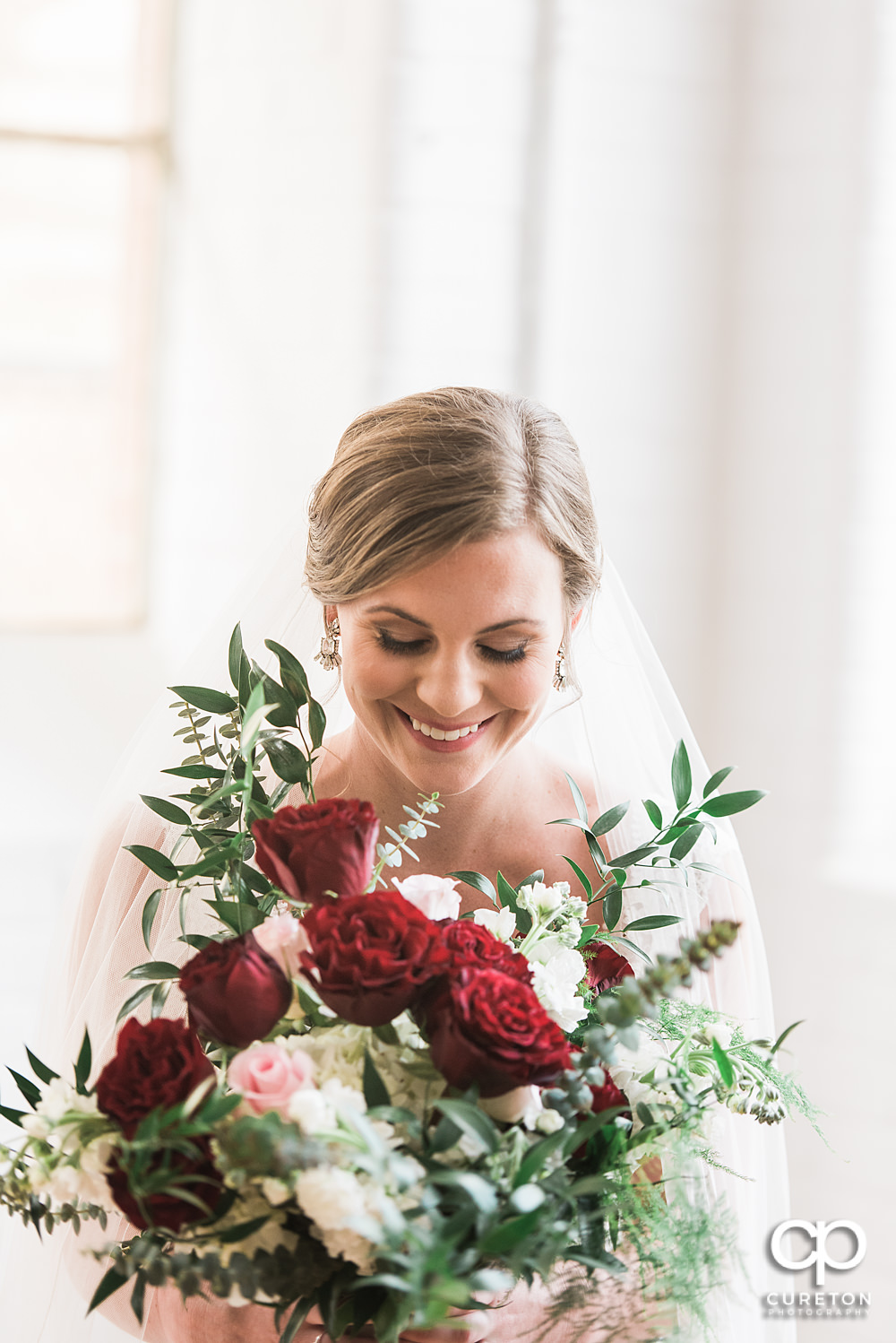 Bride laughing during her bridal session at The Southern Bleachery wedding venue at the Taylor Mill.