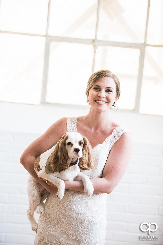 Bride holding her dog during her bridal session.