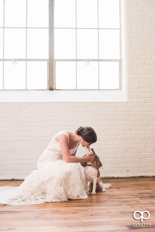 Bride kissing her dog during her bridal session.