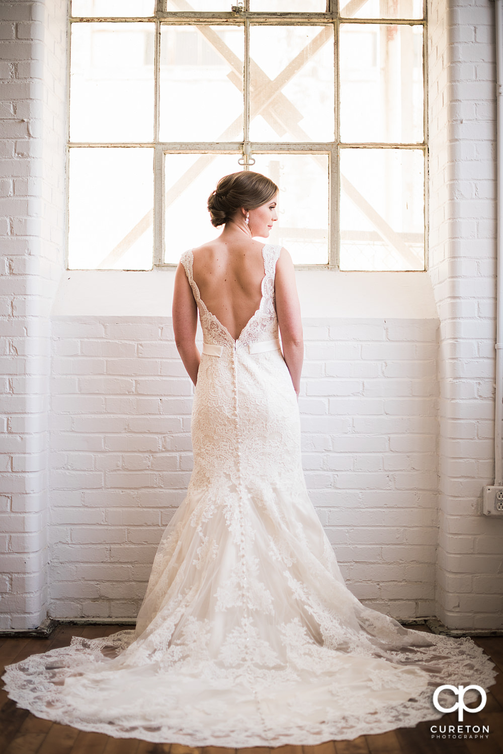 Teh back of the brides dress during her bridal session at Southern Bleachery.