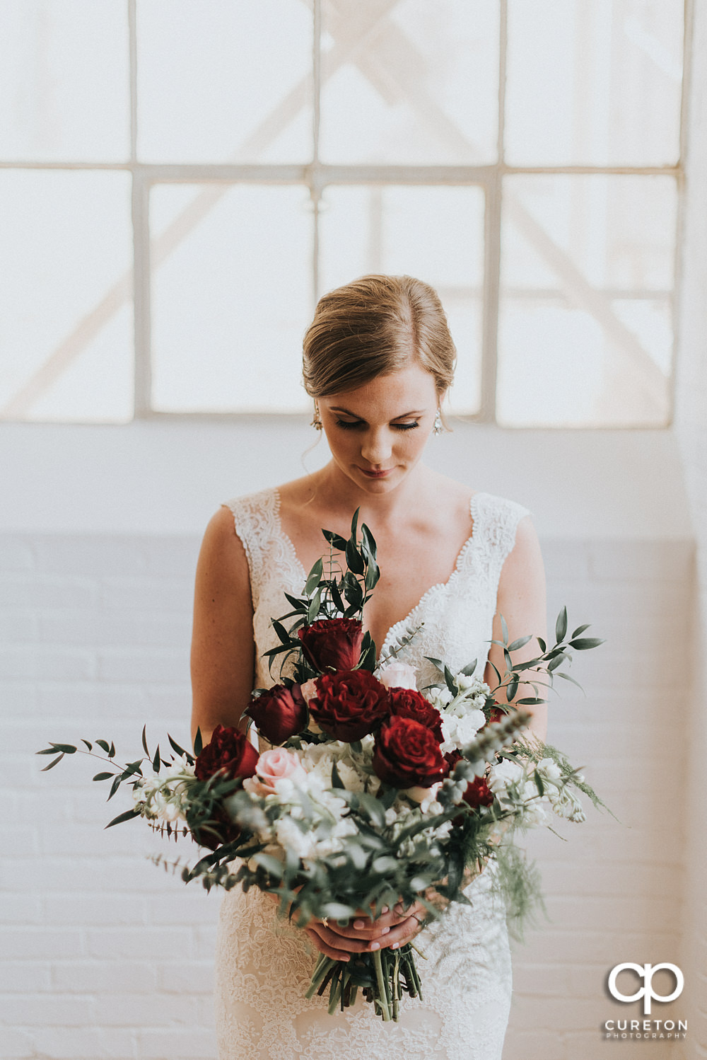 Bride looking at her flowers at the Southern Bleachery.