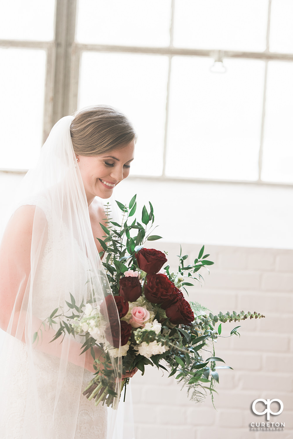 Bride laughing at Southern Bleachery.