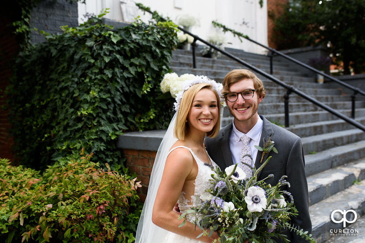 Bride and groom outside of Grace and Peace church in Greenville,SC.