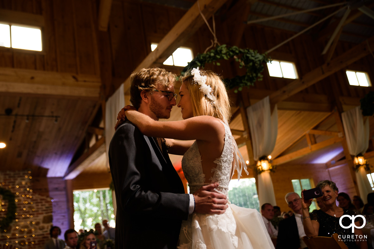 Bride and groom sharing a first dance at the wedding reception at South Wind Ranch in Travelers Rest,SC.