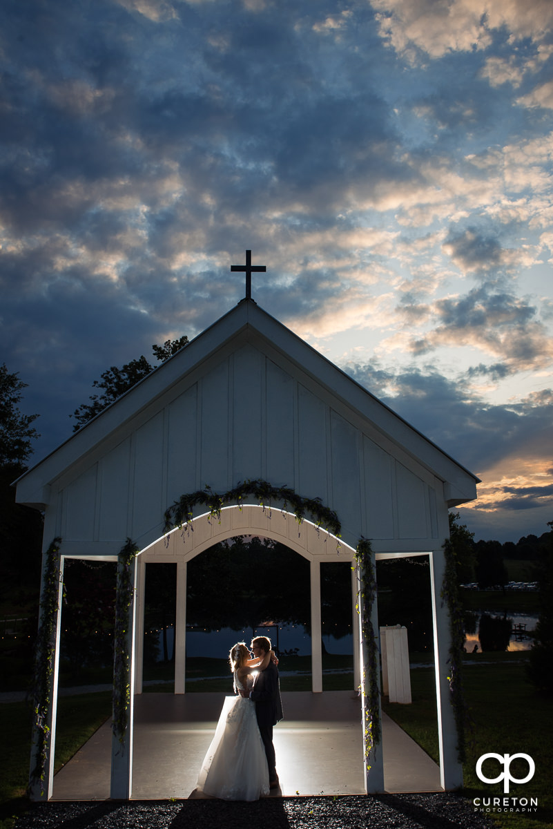 Bride and groom dancing in the open air chapel at the wedding reception at South Wind Ranch in Travelers Rest,SC.