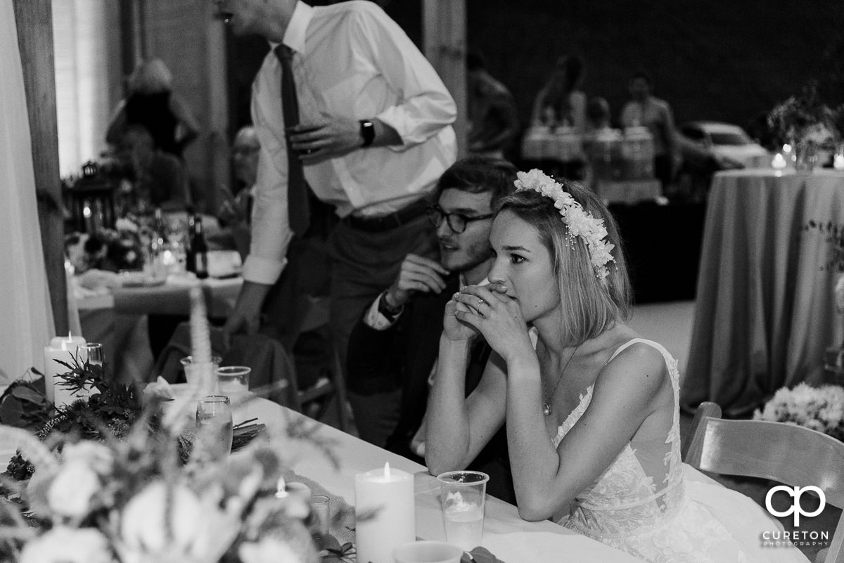 Bride and groom watching the wedding speeches.