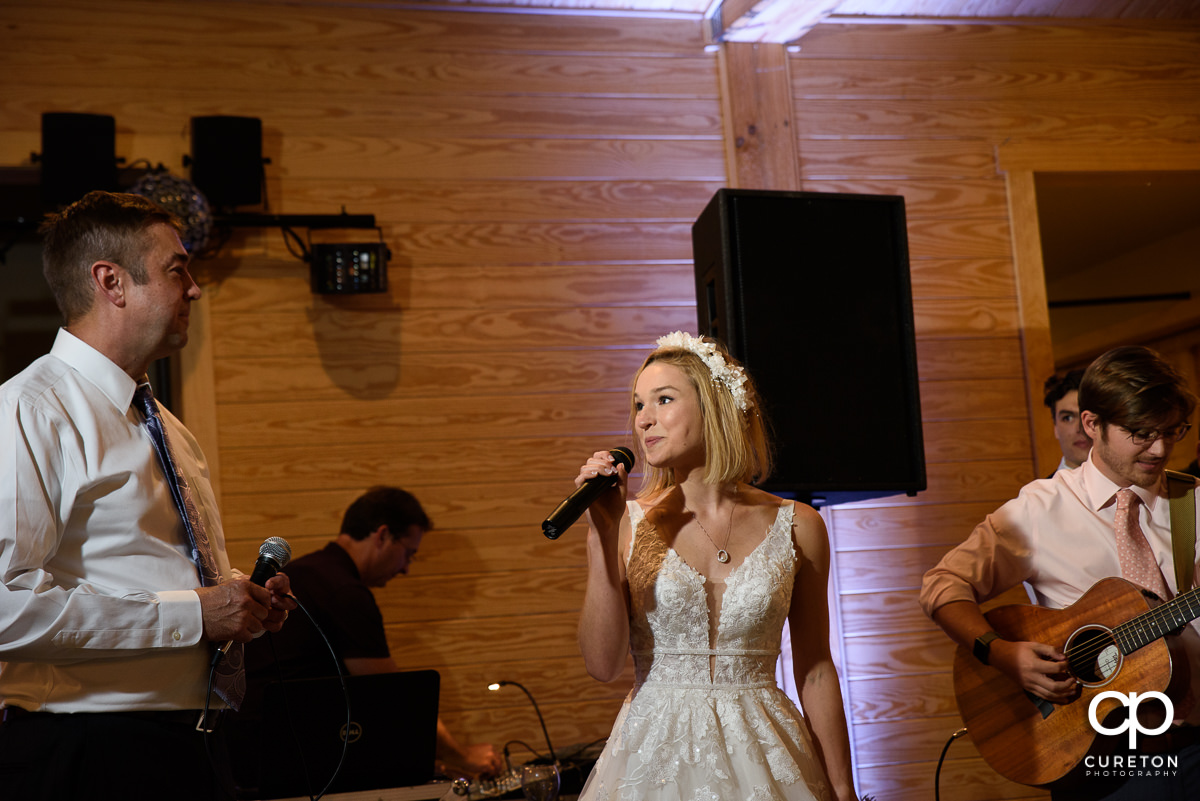 Bride and her dad singing a song together at the wedding reception.