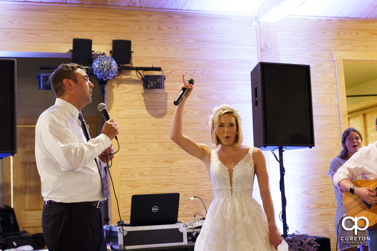 Bride and her dad singing together.