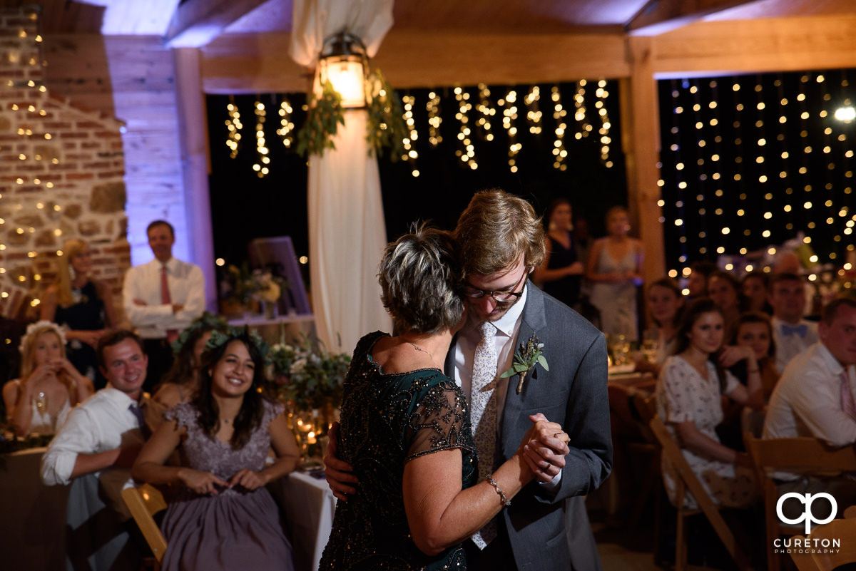 Groom dancing with his mother at the wedding reception at South Wind Ranch in Travelers Rest,SC.