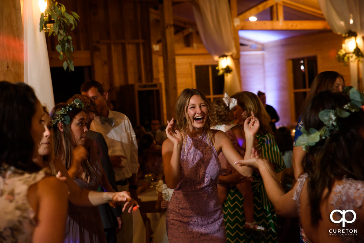 Guests dancing at the wedding reception at South Wind Ranch in Travelers Rest,SC.