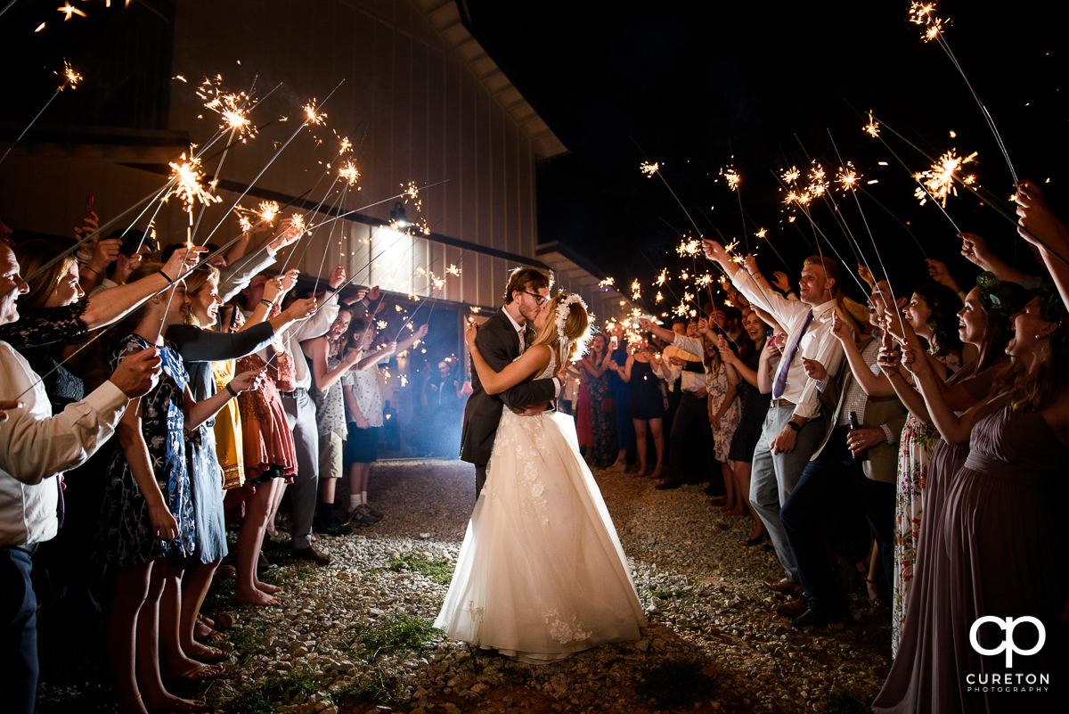 Bride and groom making a grand sparkler exit at the wedding reception at South Wind Ranch in Travelers Rest,SC.