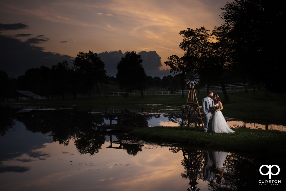 Bride and groom in a reflection at their South Wind Ranch wedding.
