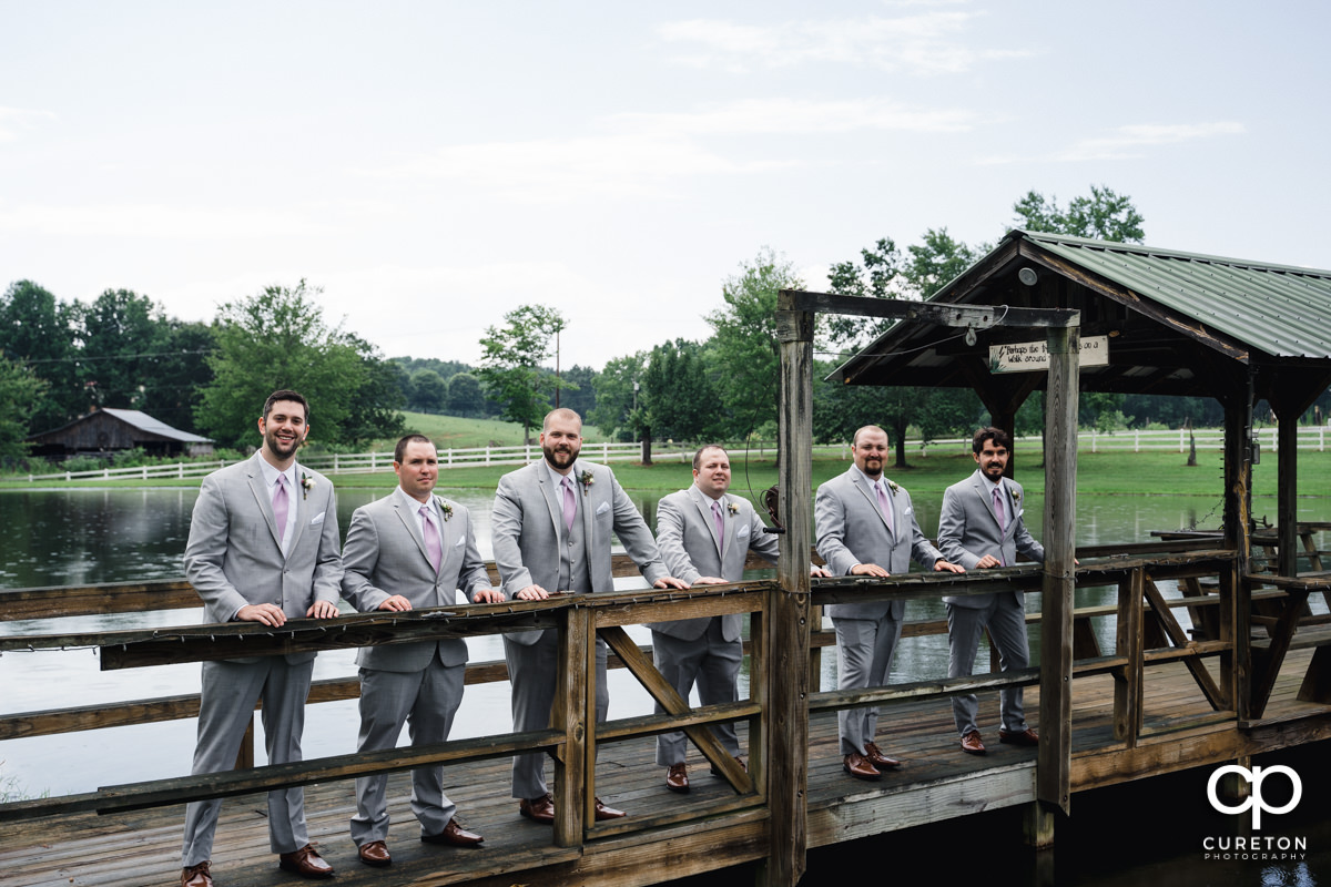 Groomsmen on a dock.