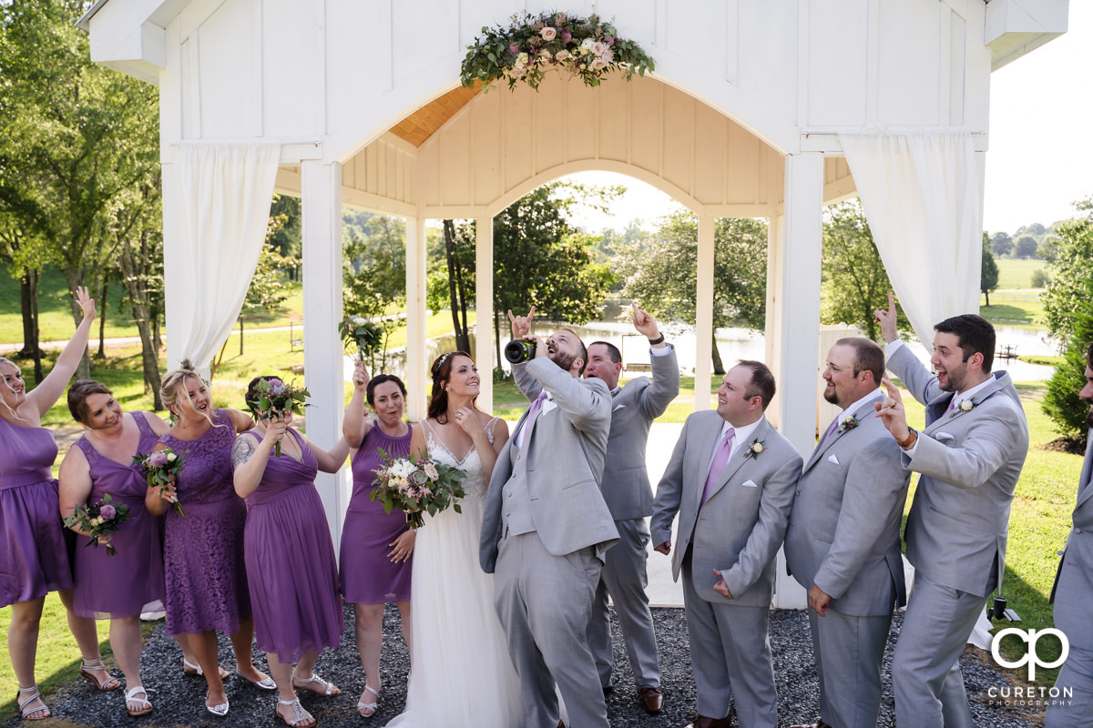 Groom drinking champagne.