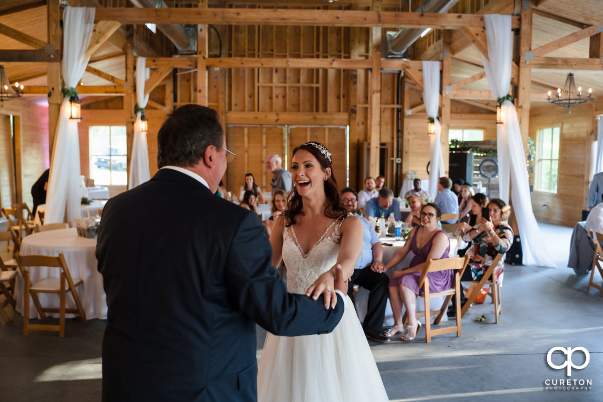 Bride dancing with her dad.