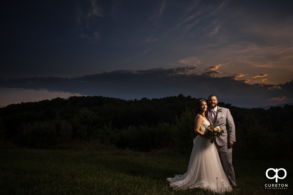 Bride and groom in front of an epic sunset.