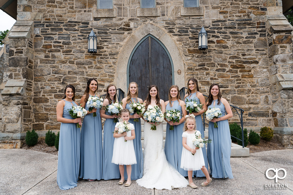 Bride and her bridesmaids outside of the church.
