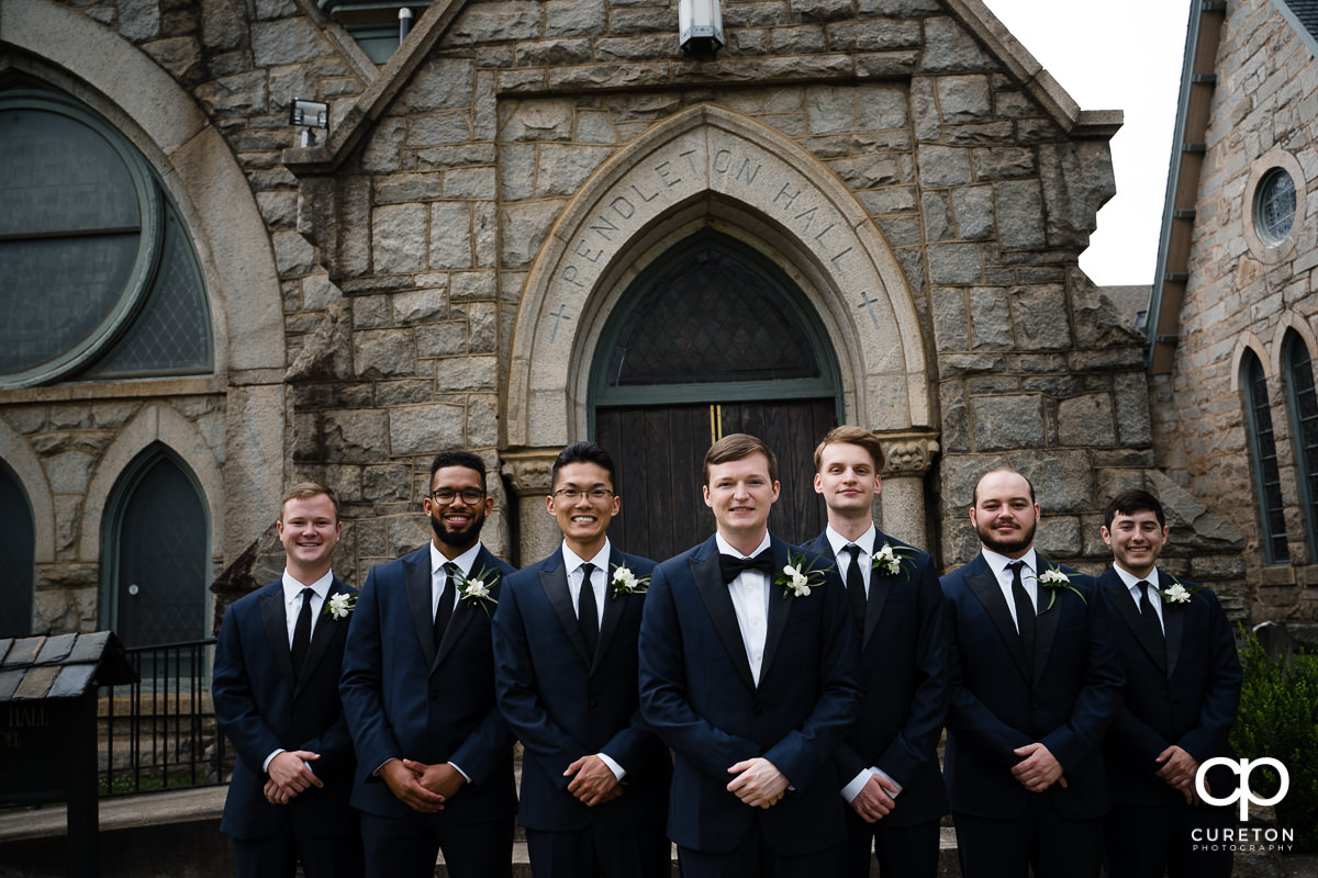 Groom and groomsmen standing outside of a church in Spartanburg.
