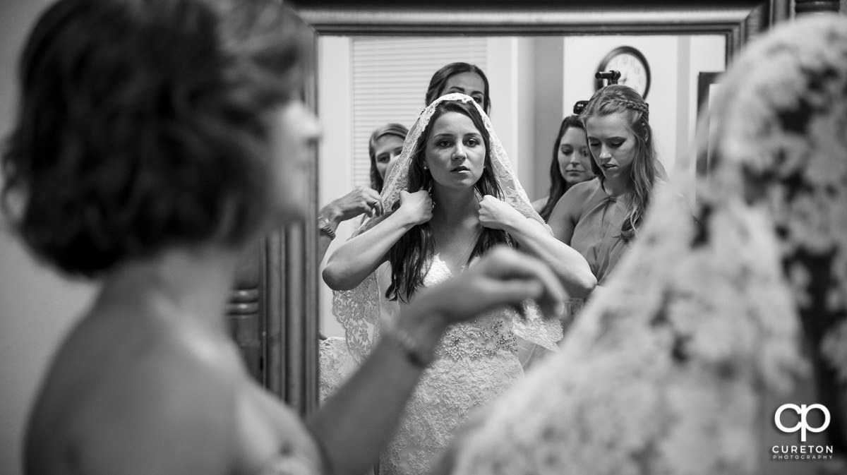 Bride getting ready at the church.