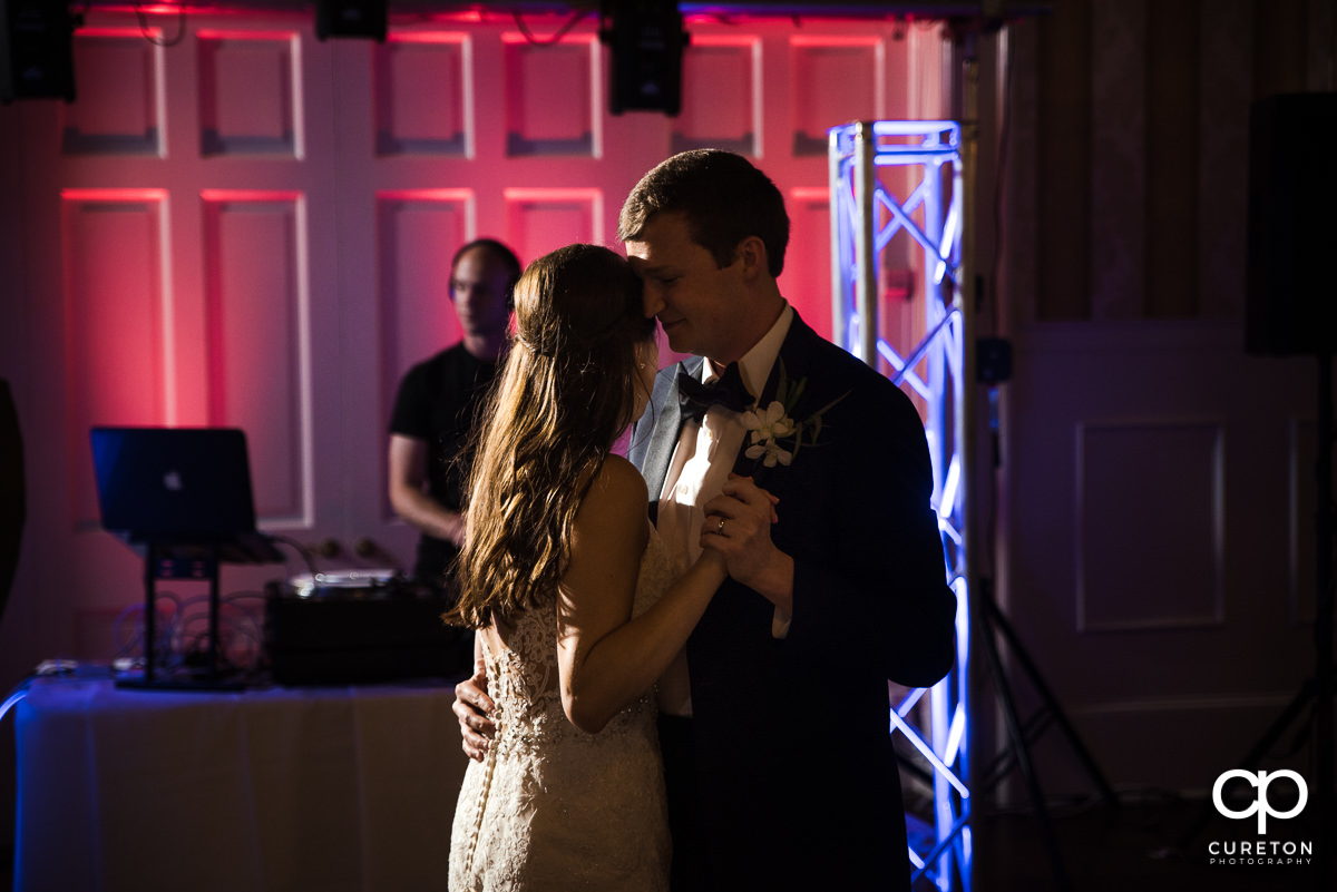 Bride and groom sharing a first dance at the wedding reception at Spartanburg Country Club.