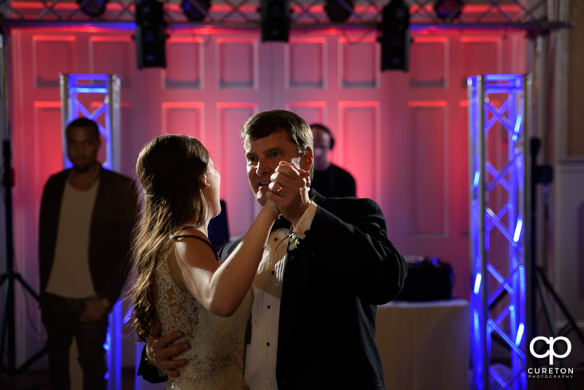 Bride sharing a dance with her father at the wedding reception at Spartanburg Country Club.