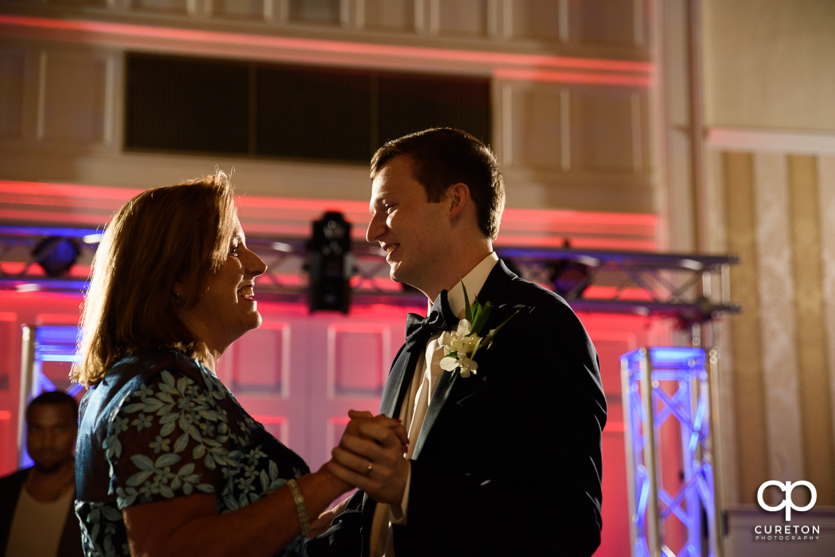 Groom and his mom dancing at the wedding reception at Spartanburg Country Club.
