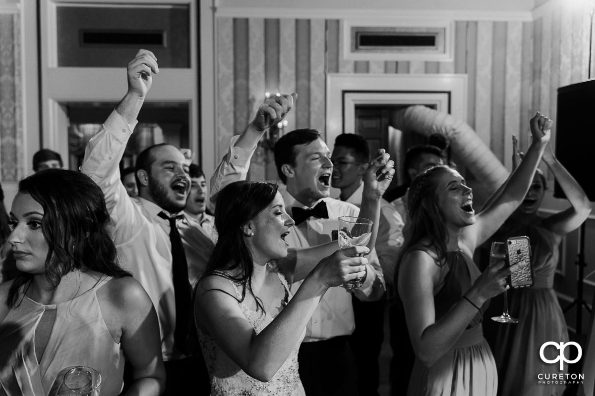 Wedding guests cheering.