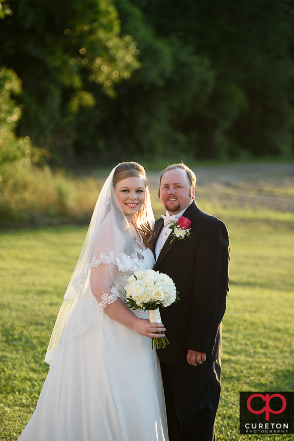 Couple posing for some shots after their Sumter,SC wedding.