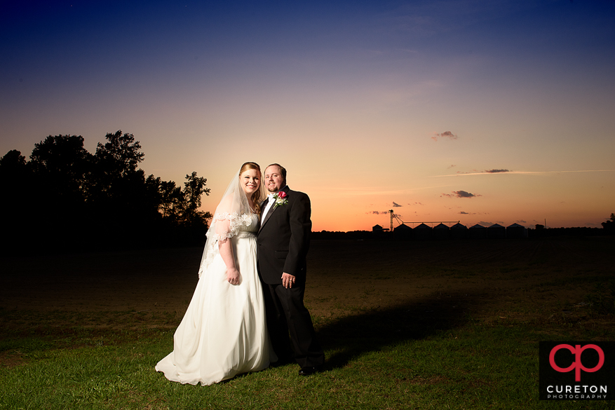 Couple at sunset near a farm in Sumter,SC.