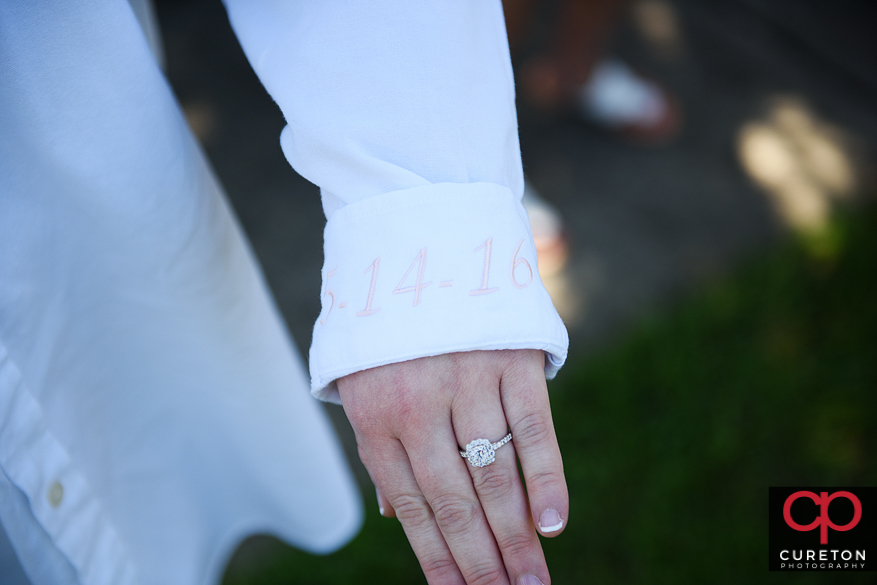 Teh brides shirt with the date on it.