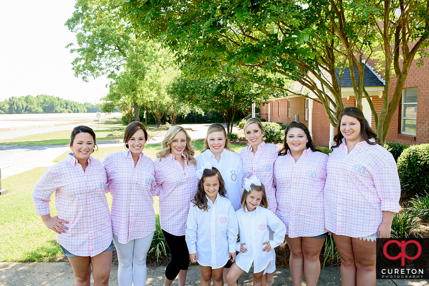 Bride and her bridesmaids in matching embroidered shorts pre-wedding.