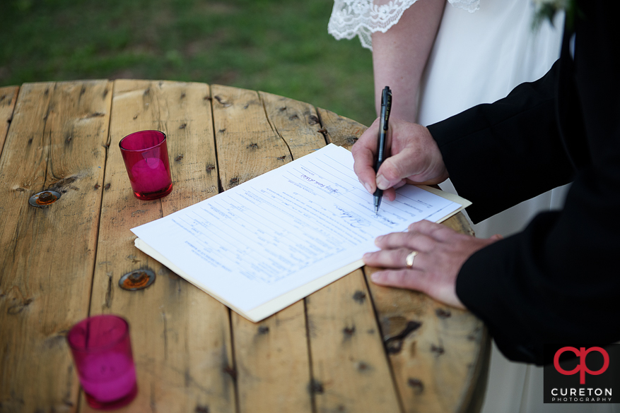 The signing of the marriage license..
