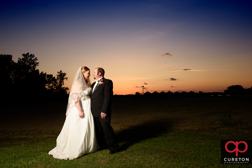 Bride and groom at sunset.