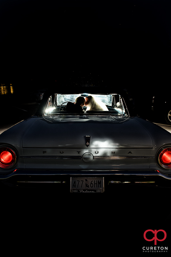 Bride and groom leaving in a vintage car from their Sumter,SC wedding.